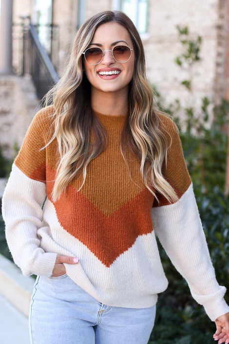 Model wearing the Color Block Sweater in Camel with high rise jeans from Dress Up Front View