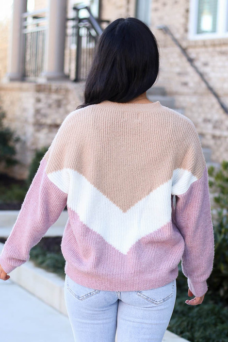 Model wearing the Color Block Sweater in Taupe with high rise jeans from Dress Up Back View