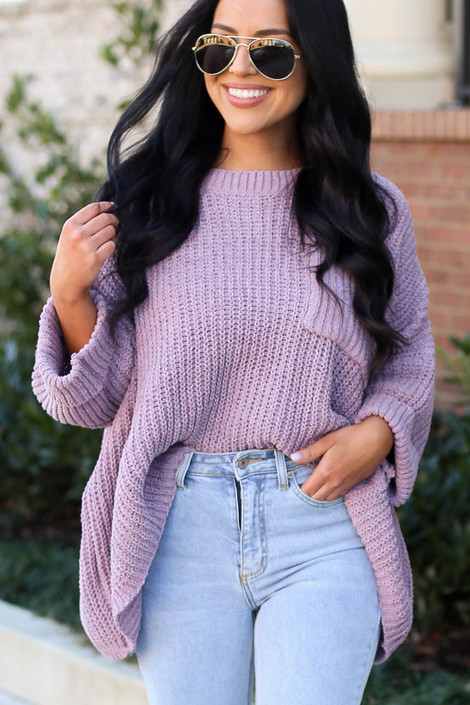 Model wearing the Oversized Chenille Sweater in Lilac tucked into light wash denim jeans