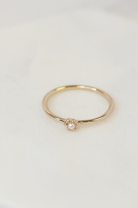 Close Up of the Gold single pearl ring in the Assorted Dainty Ring Set