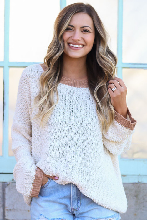 Model wearing the Ivory Fuzzy Popcorn Knit Contrast Top with cut off jean shorts Front View