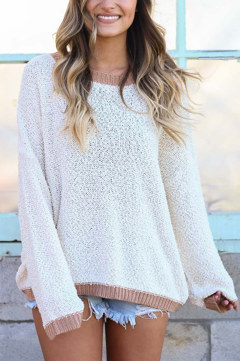 Model wearing the Ivory Fuzzy Popcorn Knit Contrast Top with denim shorts from Dress Up Front View
