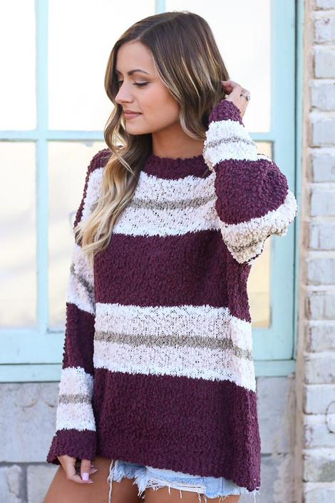 Model wearing the Striped Popcorn Knit Oversized Top in Burgundy with denim shorts Side View
