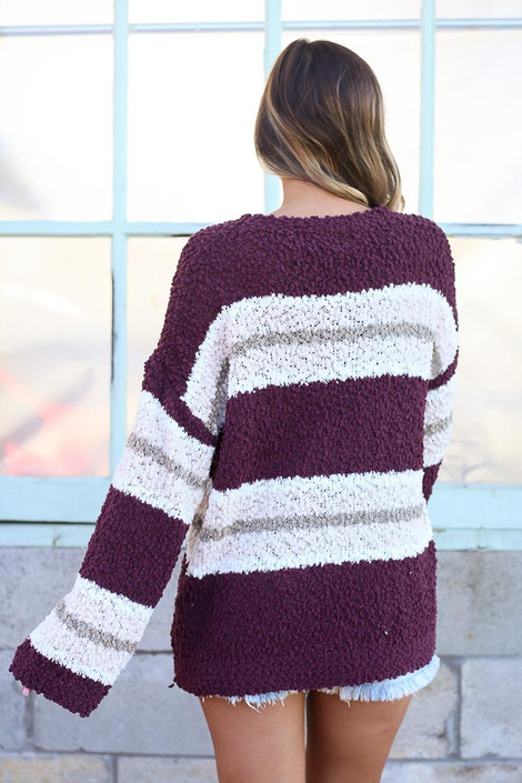 Model wearing the Striped Popcorn Knit Oversized Top in Burgundy with denim shorts Back View