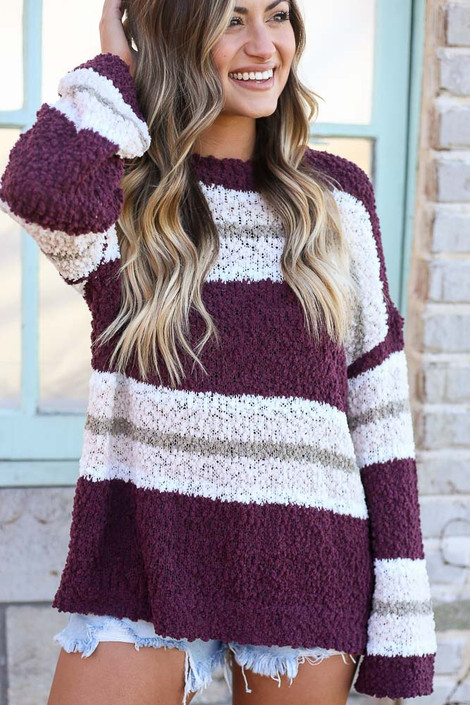 Model wearing the Striped Popcorn Knit Oversized Top in Burgundy with denim shorts Close Up Front View