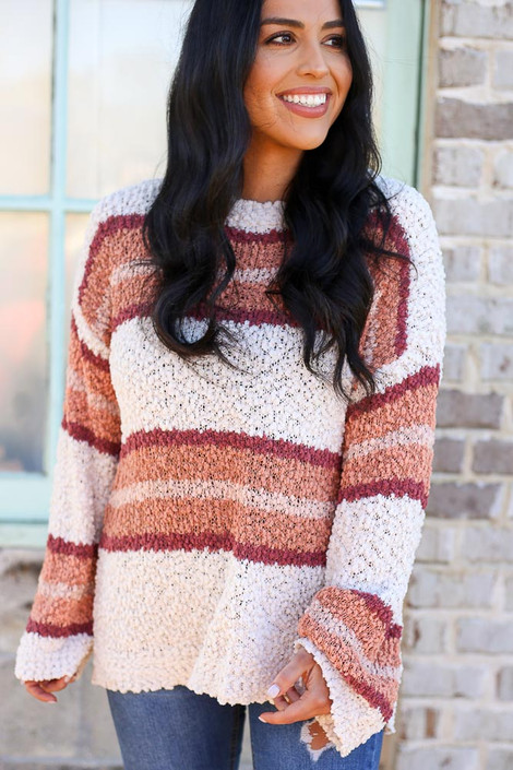 Natural - Model wearing the Striped Popcorn Knit Oversized Top in Natural with high rise jeans from Dress Up Boutique Front View