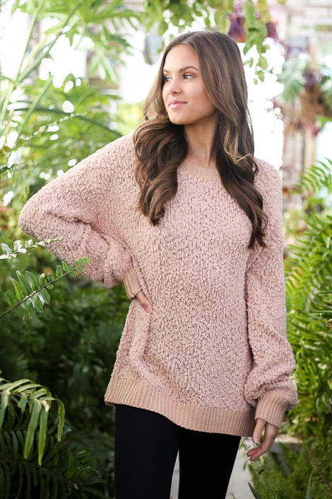 Model wearing the Popcorn Knit Oversized Top in Blush with black skinny jeans from Dress Up