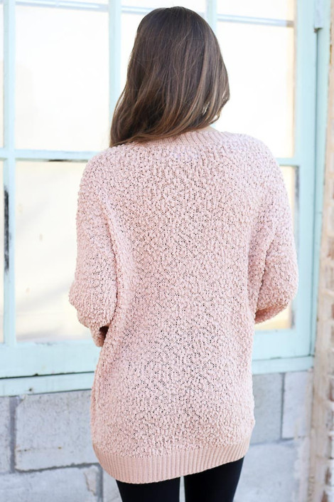 Model wearing the Popcorn Knit Oversized Top in Blush with black skinny jeans from Dress Up Back View