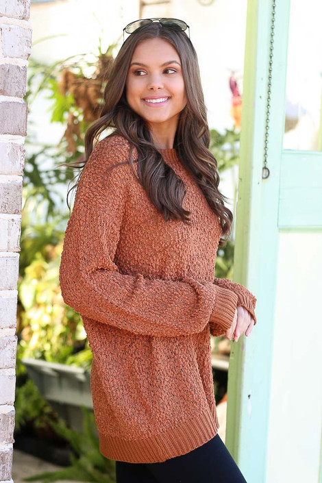 Model wearing the Popcorn Knit Oversized Top in Rust with black skinny jeans from Dress Up Boutique Side View