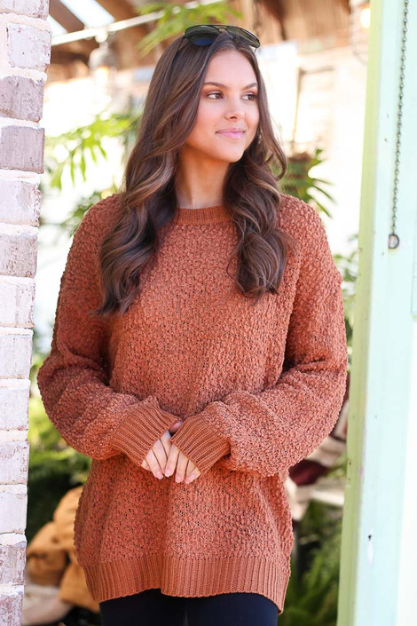 Model wearing the Popcorn Knit Oversized Top in Rust with black skinny jeans from Dress Up