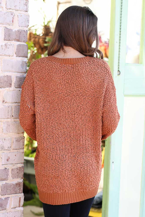 Model wearing the Popcorn Knit Oversized Top in Rust with black skinny jeans from Dress Up Boutique Back View