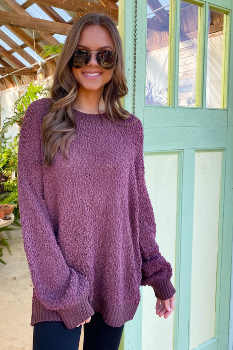 Model wearing the Popcorn Knit Oversized Top in Marsala with high rise skinny jeans from Dress Up Boutique Front View