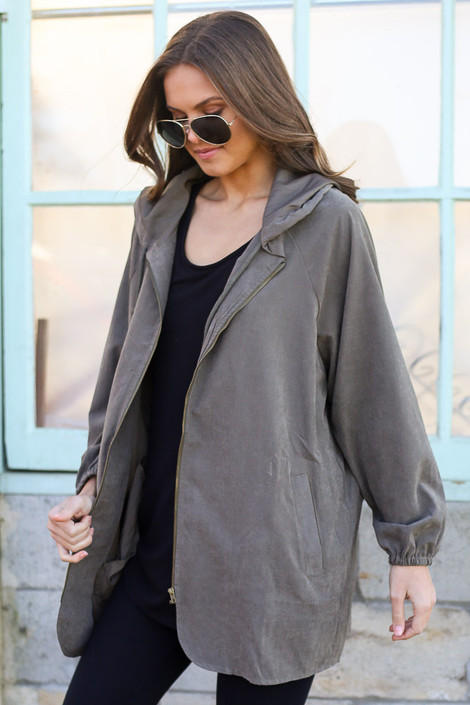 Model wearing the Hooded Utility Jacket in Olive with Black tank top and black skinny jeans from Dress Up Side View