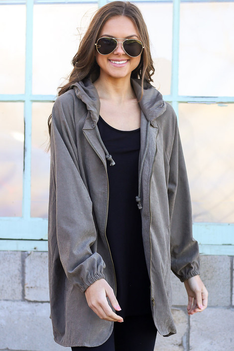 Model wearing the Hooded Utility Jacket in Olive with Black tank top and black skinny jeans from Dress Up Unzipped Front View