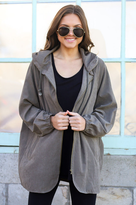 Model wearing the Hooded Utility Jacket in Olive with Black tank top and black skinny jeans from Dress Up Front View