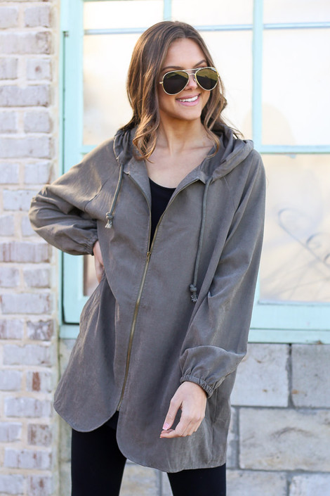 Model wearing the Hooded Utility Jacket in Olive with Black tank top and black skinny jeans from Dress Up Zipped Up Front View