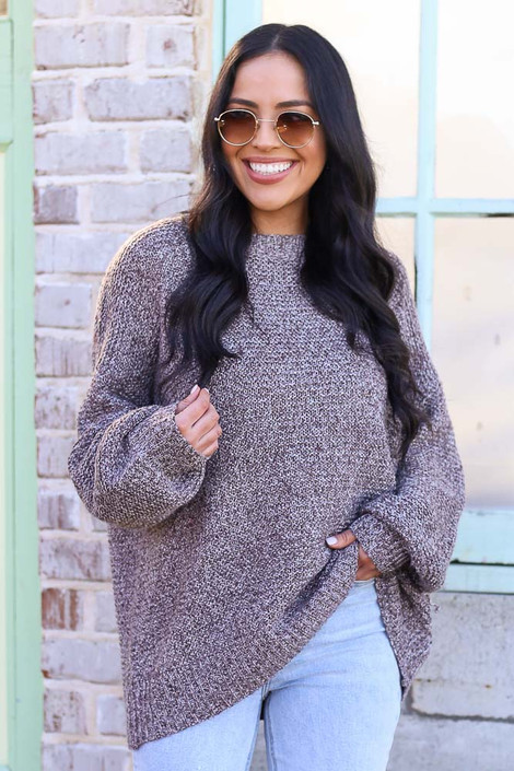 Model wearing the Mocha Balloon Sleeve Oversized Knit Top with high rise jeans Front View