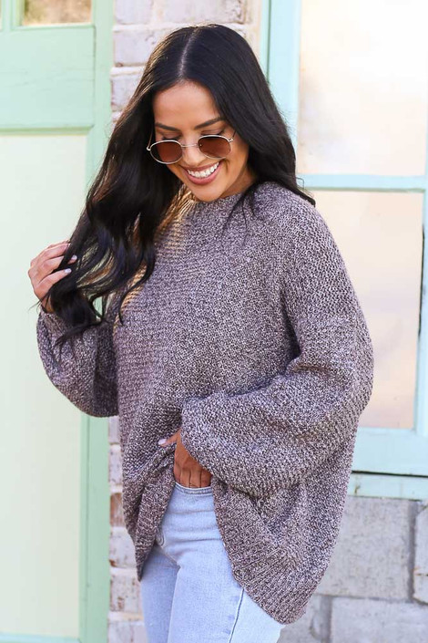 Model wearing the Mocha Balloon Sleeve Oversized Knit Top with high rise jeans Side View