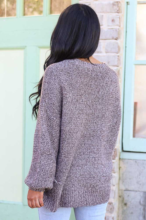 Model wearing the Mocha Balloon Sleeve Oversized Knit Top with high rise jeans Back View