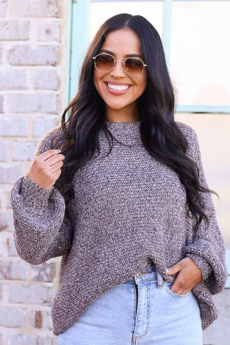 Model wearing the Mocha Balloon Sleeve Oversized Knit Top with high rise jeans from Dress Up Front View