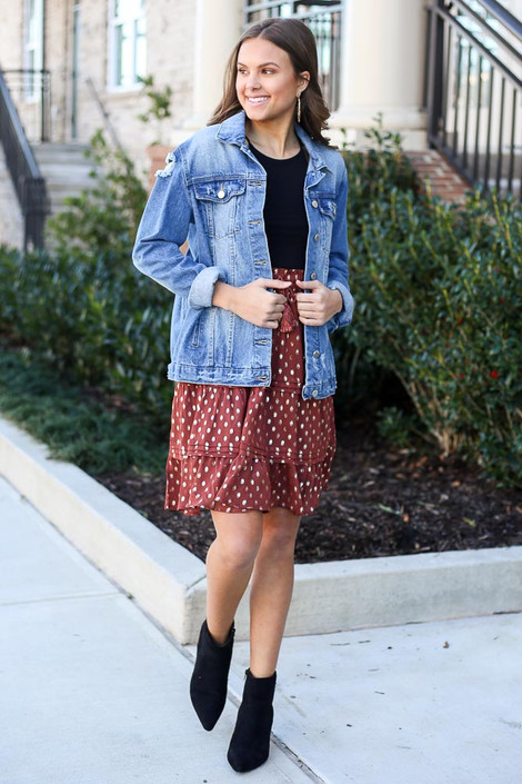 Model wearing the Rust Metallic Polka Dot Tiered Skirt with black bodysuit and distressed denim jacket from Dress Up