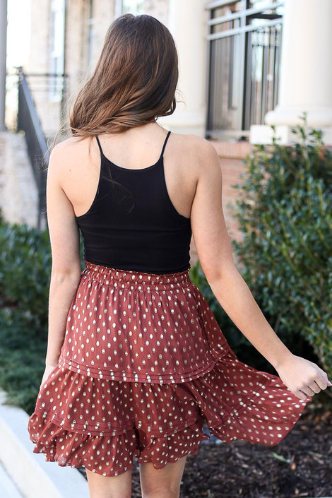 Model wearing the Rust Metallic Polka Dot Tiered Skirt with black bodysuit from Dress Up Back View