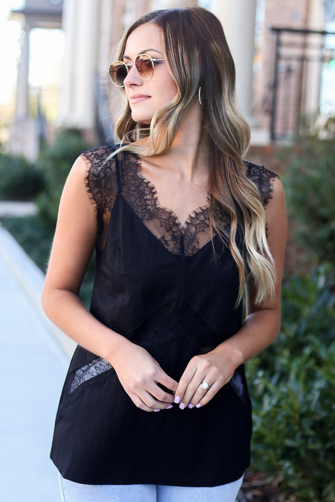 Model wearing the Black Lace Tank with high rise jeans and sunglasses Back View