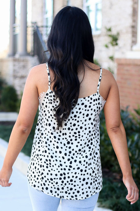 Model wearing the Spotted Lace Tank in Ivory with high rise jeans Back View