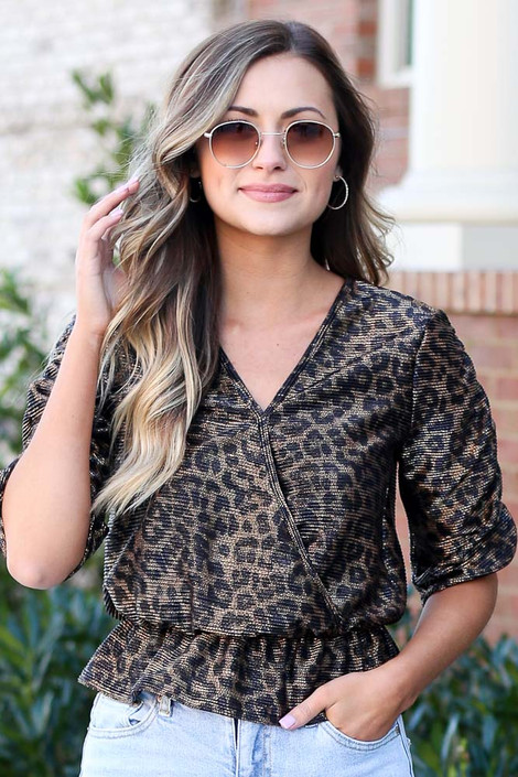 Model wearing the Draped Sleeve Leopard Blouse with high rise jeans from Dress Up Front View