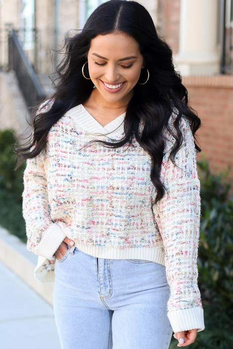 Model wearing the Ivory Confetti Metallic Eyelash Knit Oversized Sweater with high rise jeans from ShopDressUp