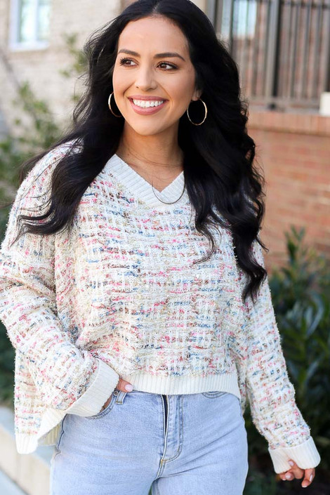 Model wearing the Ivory Confetti Metallic Eyelash Knit Oversized Sweater with high rise jeans from ShopDressUp Front View