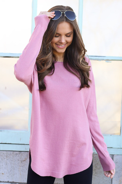 Model wearing the Blush Soft Knit Top with black skinny jeans from Dress Up Boutique Front View