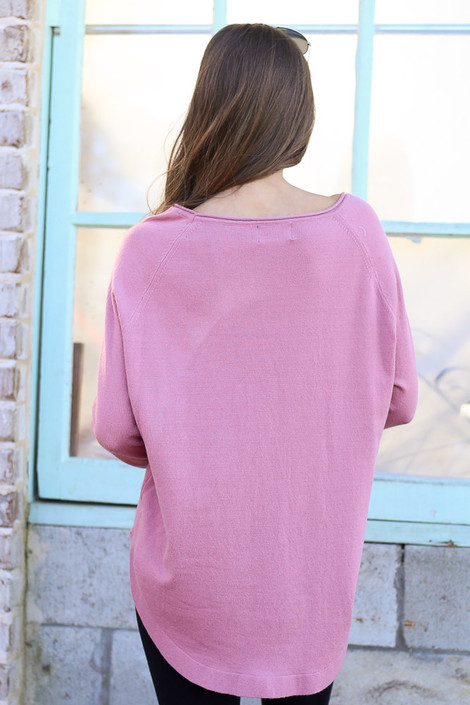 Model wearing the Blush Soft Knit Top with black skinny jeans Back View