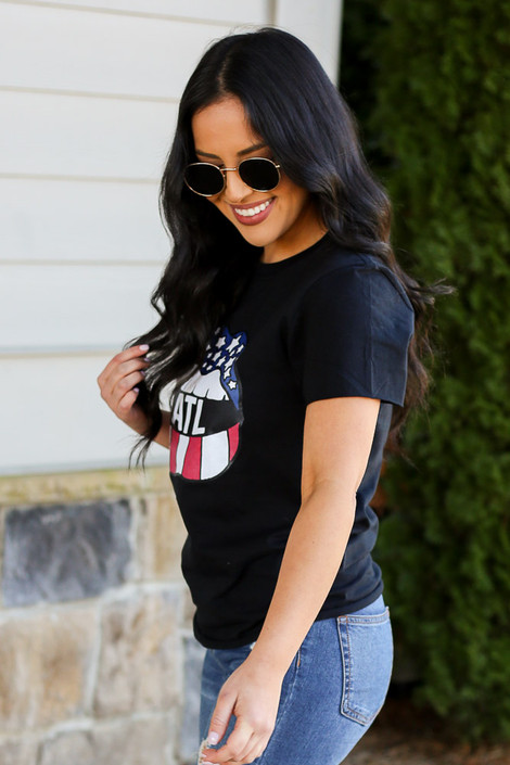 Model wearing the Atlanta Graphic Tee with high rise jeans from Dress Up Side View