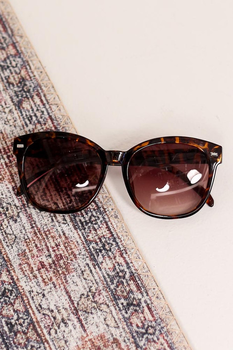 Tortoise - Flat Lay of the Horn Rimmed Sunglasses