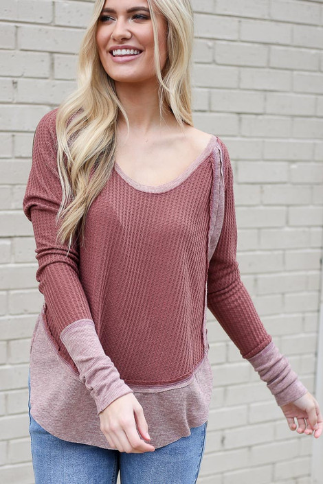 Model wearing the Contrast Waffle Knit Top in Burgundy with jeans