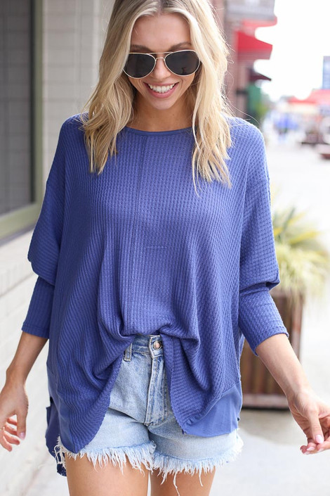 Blue - Model wearing the Blake Oversized Top with denim shorts