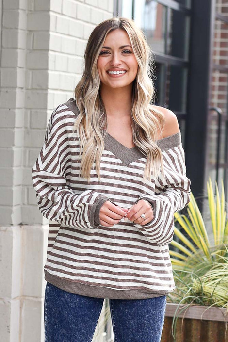 Model wearing the Striped Waffle Knit Oversized Top in Mocha with high rise jeans Front View