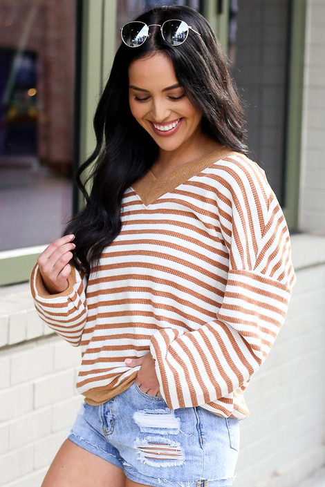 Model wearing the Striped Waffle Knit Oversized Top in Camel with sunglasses