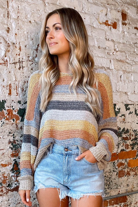 Dress Up model wearing the Striped Loose Knit Top with denim shorts and booties