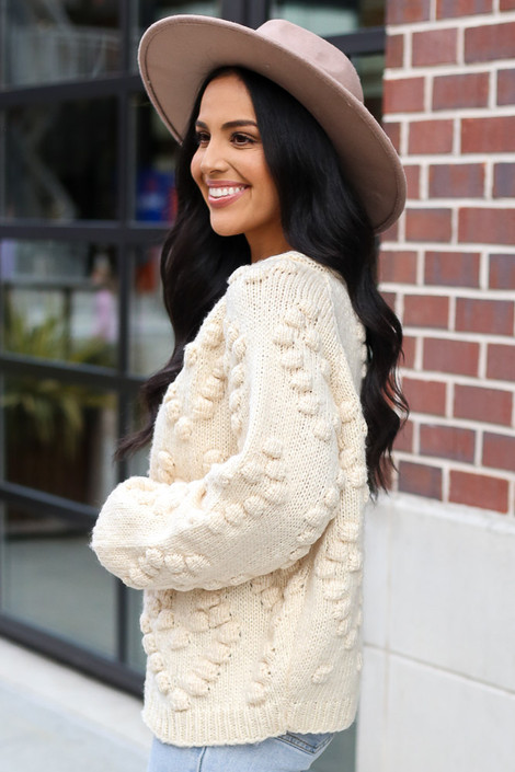 Pom Pom Heart Knit Cardigan in Ivory from Dress Up Boutique