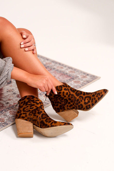 Model wearing the Leopard Microsuede Block Heel Booties Sitting Side View from Dress Up
