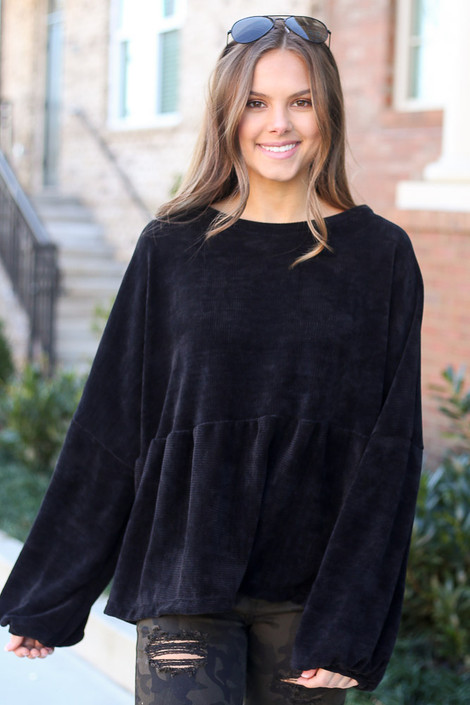 Model wearing the Velour Knit Oversized Babydoll Top in Black