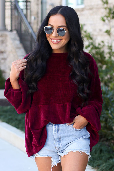 Model wearing the Velour Knit Oversized Babydoll Top in Burgundy
