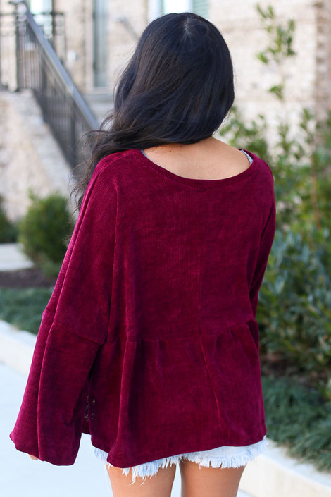 Model wearing the Velour Knit Oversized Babydoll Top in Burgundy Back View