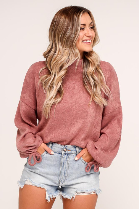 Model wearing the Balloon Sleeve Knit Top in Mauve with high rise denim shorts from Dress Up