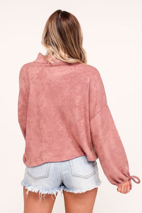 Model wearing the Balloon Sleeve Knit Top in Mauve with high rise denim shorts from Dress Up Boutique Back View