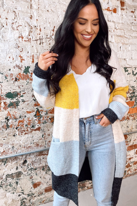 Model wearing the Color Block Knit Cardigan from Dress Up