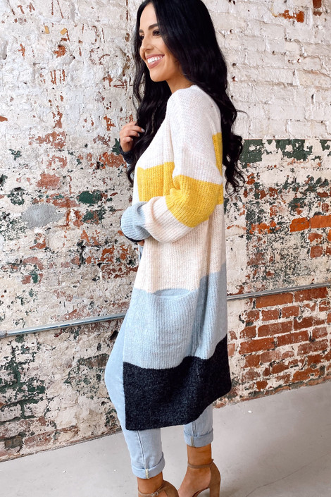 Model wearing the Color Block Knit Cardigan with a white tank and light wash jeans Side View
