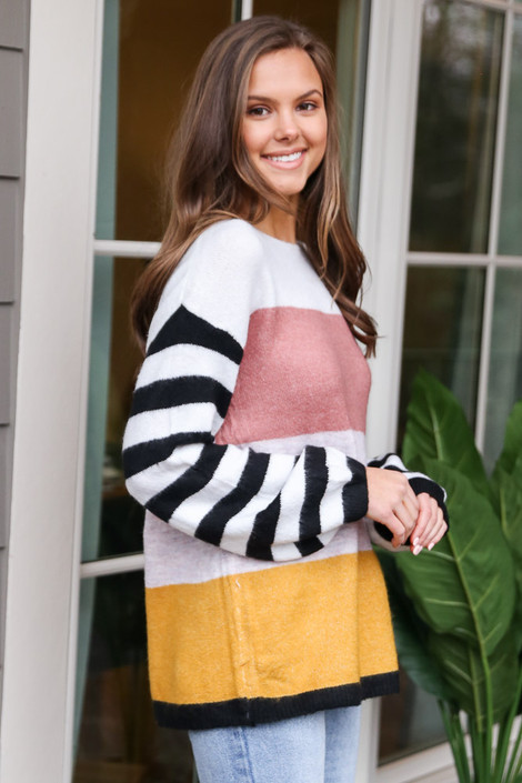 Model wearing the Oversized Color Block Knit Top with light wash jeans from Dress Up Side View